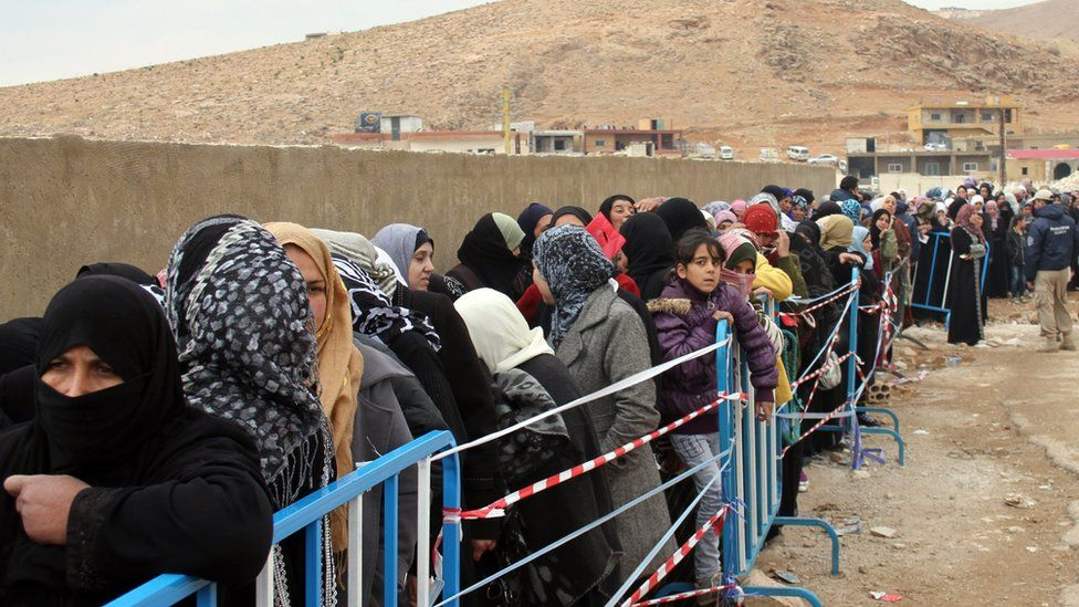 Syrian refugees wait to register upon their arrival in the strategic Lebanese border district town of Arsal on November 18, 2013, after fleeing the fighting in the neighbouring Syria.
