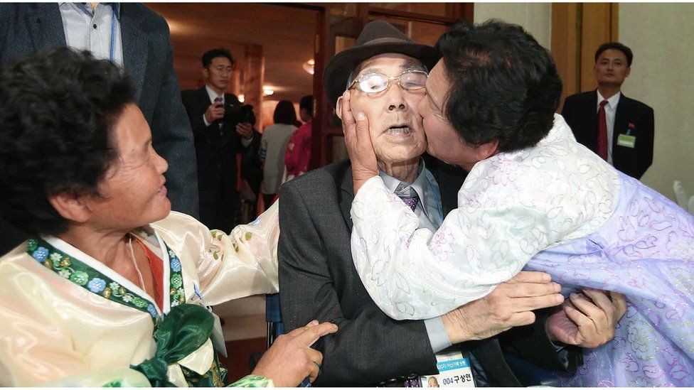 North Korean Ku Song Ok, 71 (right) kisses her South Korean father Gu Sang-yeon, 98, as her North Korean sister Ku Sun Ok, 66 (left) smiles after the Separated Family Reunion Meeting at the Diamond Mountain resort in North Korea, 26 October 2015
