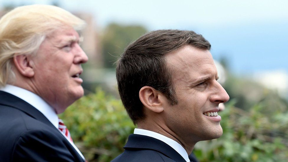 US President Donald Trump (L) and French President Emmanuel Macron watch an Italian flying squadron