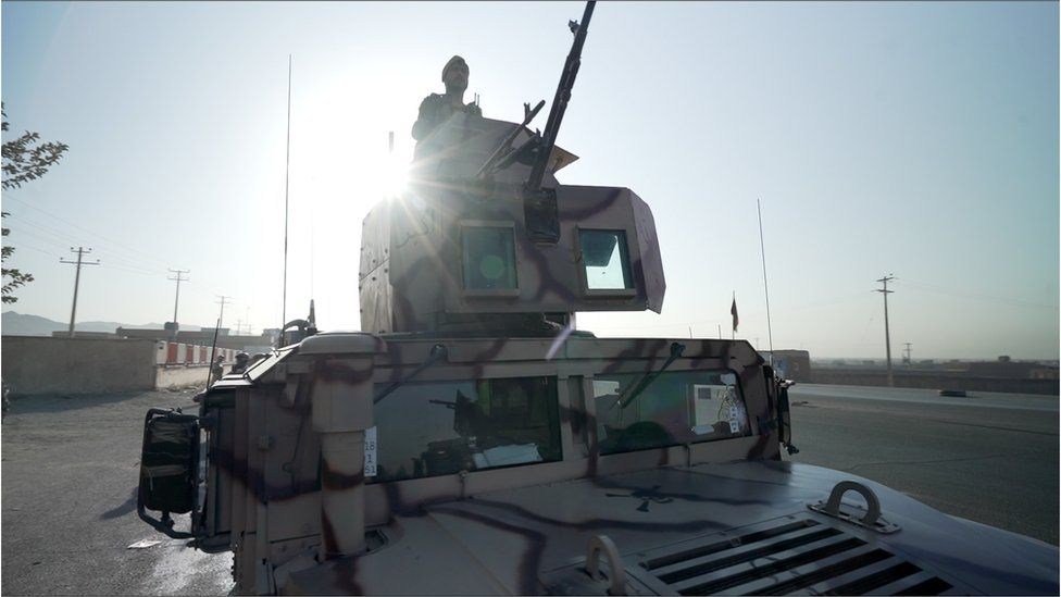Image of an Afghan soldier in a tank