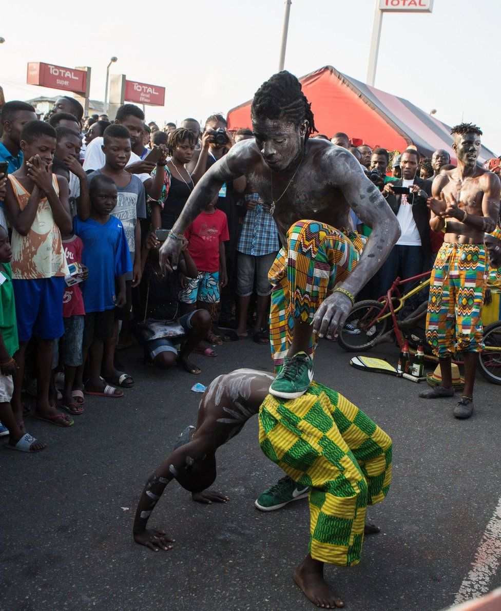 picture taken on August 19, 2017 shows acrobats performing during the annual Chale Wote Street Art Festival at James town in Accra.