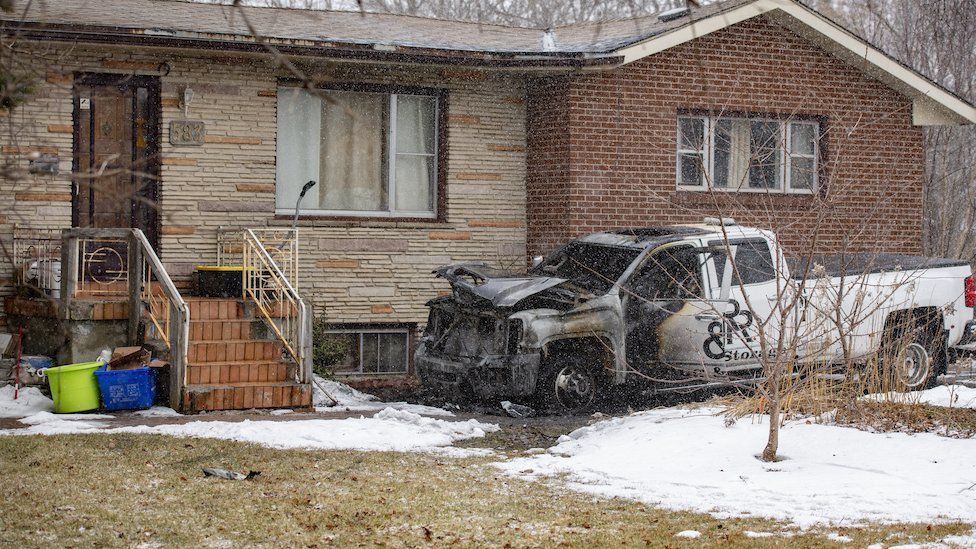 Burned-out truck outside a home in Aurora, Ontario