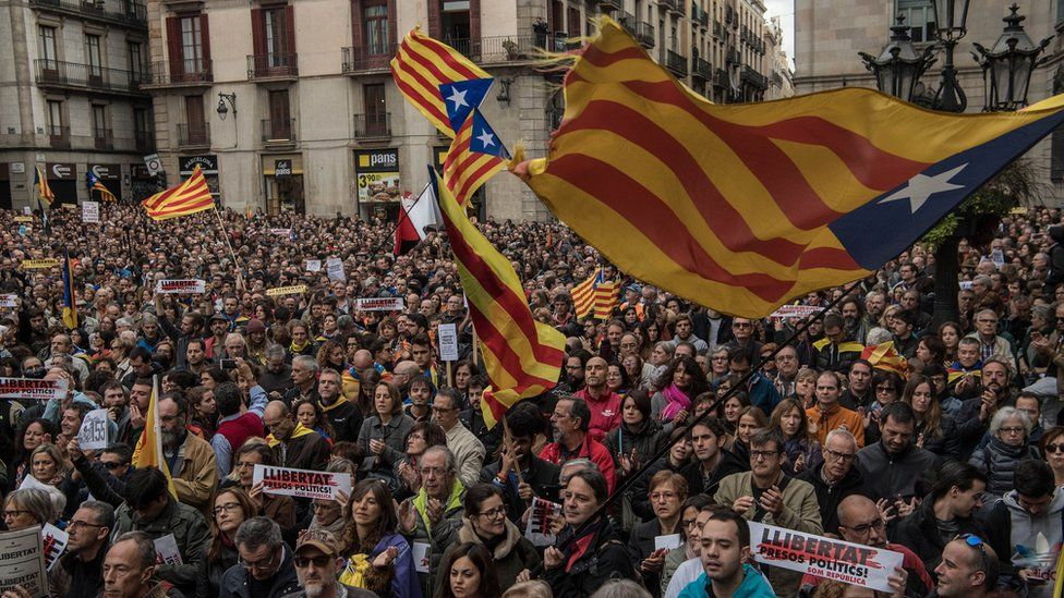 Demonstrators gather in front of the Catalan Government building