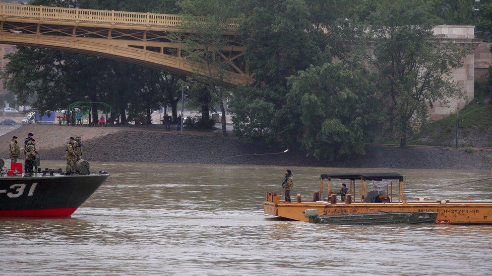 Hungarian authorities search for remains from a tourist boat that capsized on the Danube