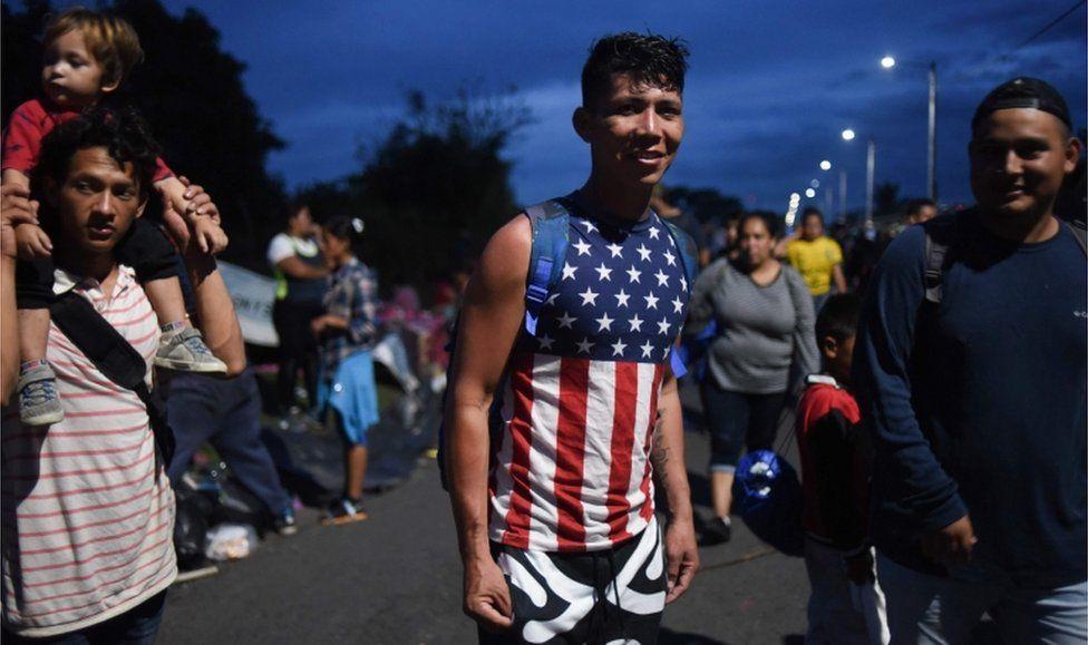 A young Honduran migrant wearing an American flag t-shirt