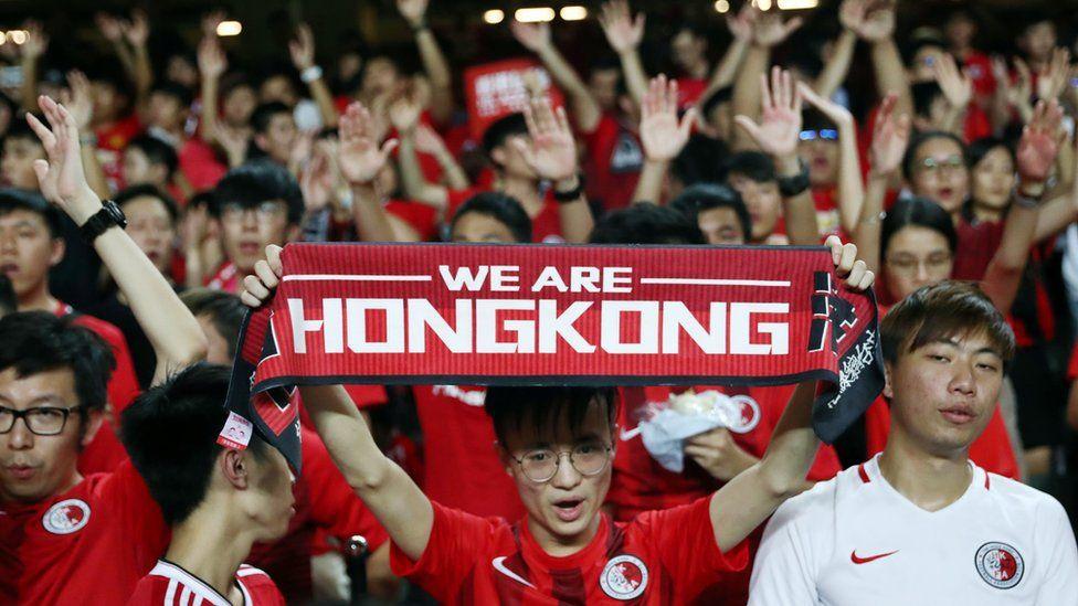 Soccer fans demonstrate inside Hong Kong Stadium