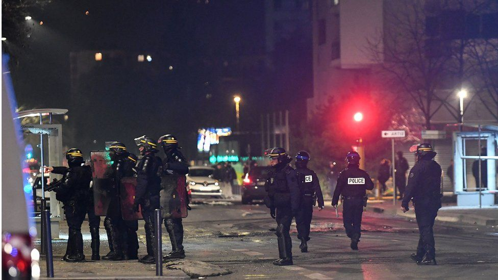 Police stand in the street in Grenoble