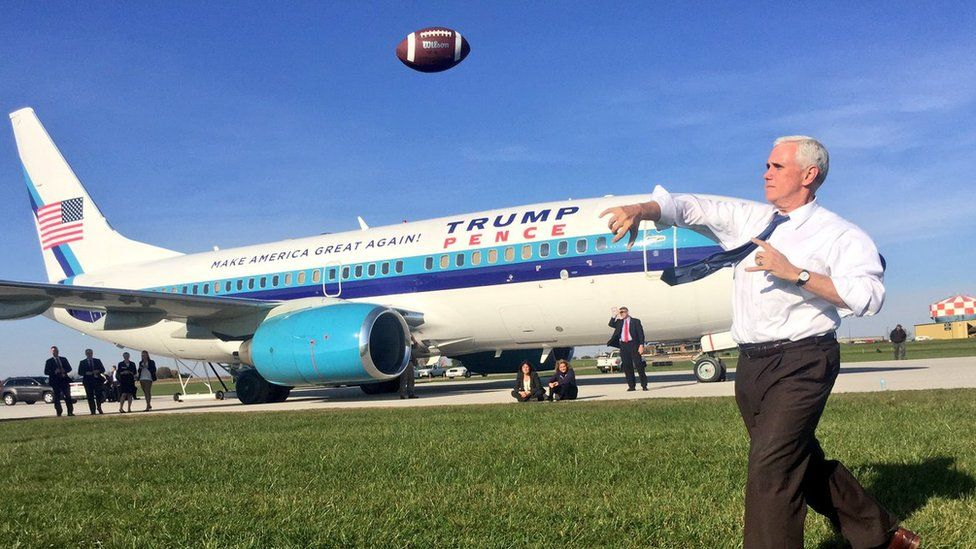 Mike Pence playing football while waiting for grounded plane
