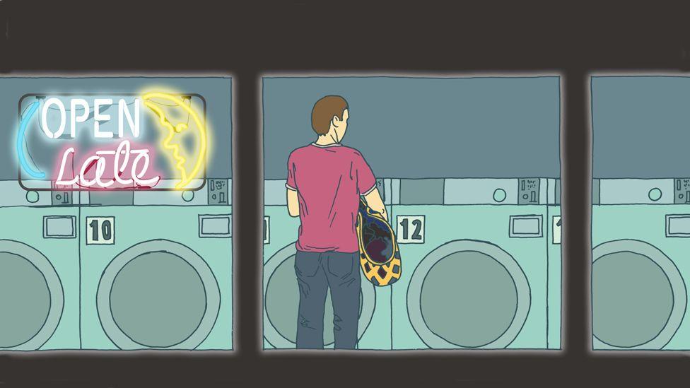 man in laundromat at night