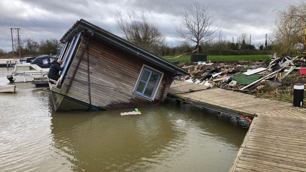 Toppled houseboat