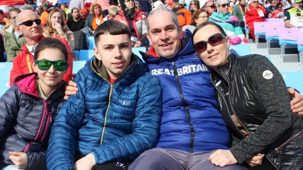 Chris with his family in the stands