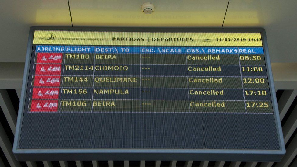 A departures board at Maputo International Airport in Mozambique lists all flights as cancelled.