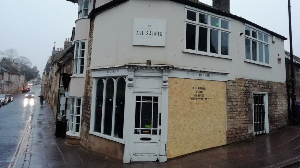 Boarded up bar in Stamford