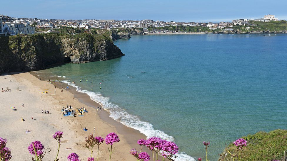 Looking over the cliffs to Tolcarne beach, Newquay in summer
