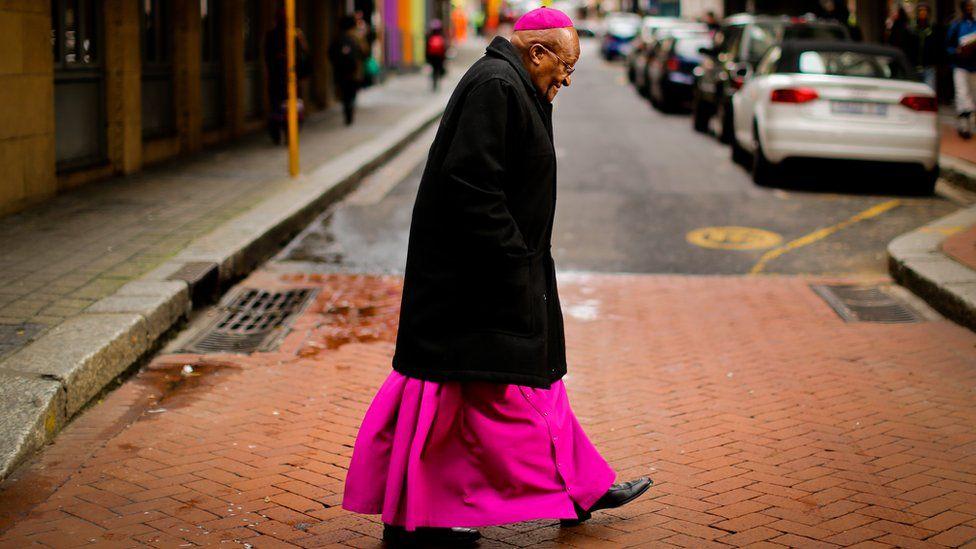 Tutu walking across a street