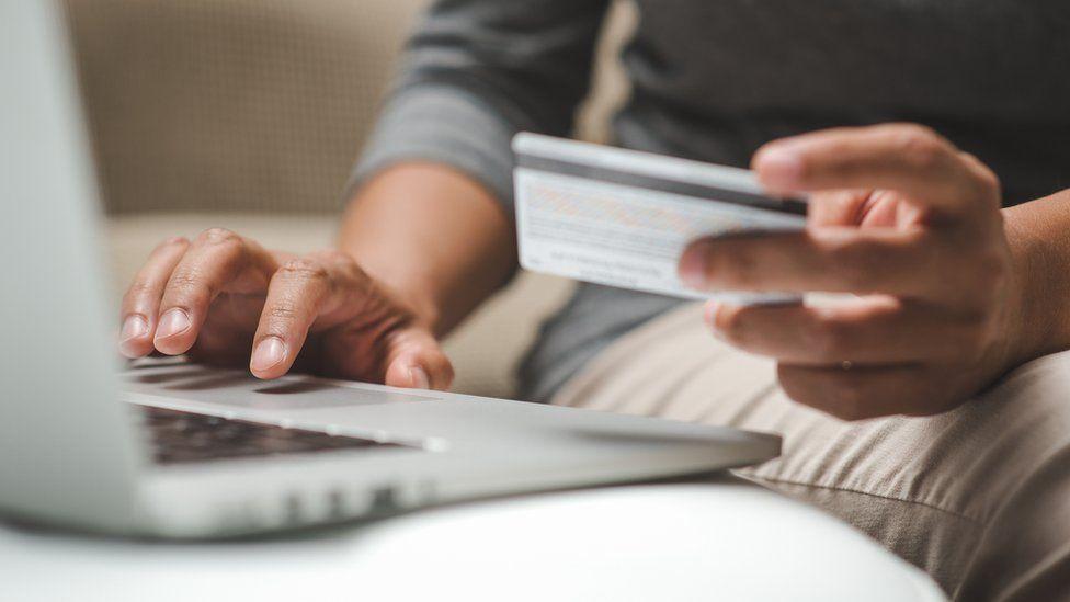 Man using credit card online