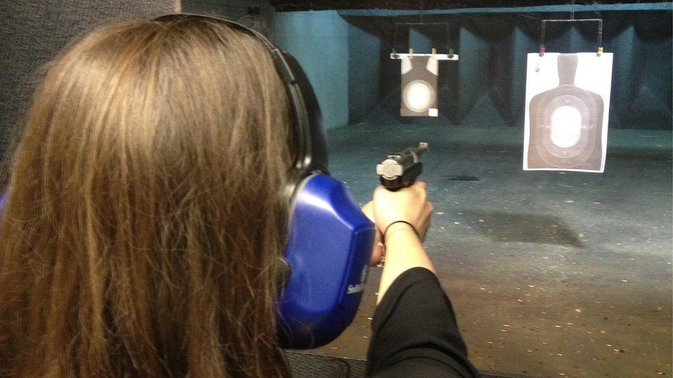 Kate Andrews shooting at a firing range