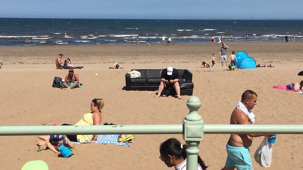 People on Edinburgh's Portobello beach in warm weather