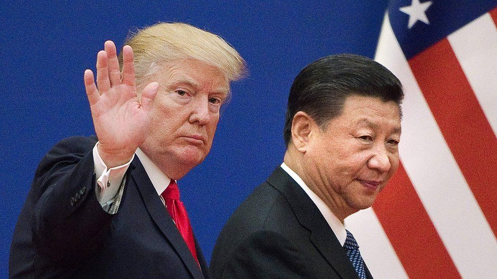 "This file picture taken on November 9, 2017, shows US President Donald Trump (L) and China""s President Xi Jinping leaving a business leaders event at the Great Hall of the People in Beijing"