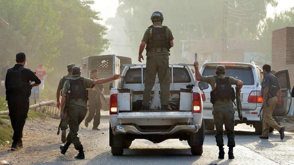 Pakistani soldiers arrive to take position outside the Pakistan Air Force base after an attack by militants in Peshawar - 18 September 2015