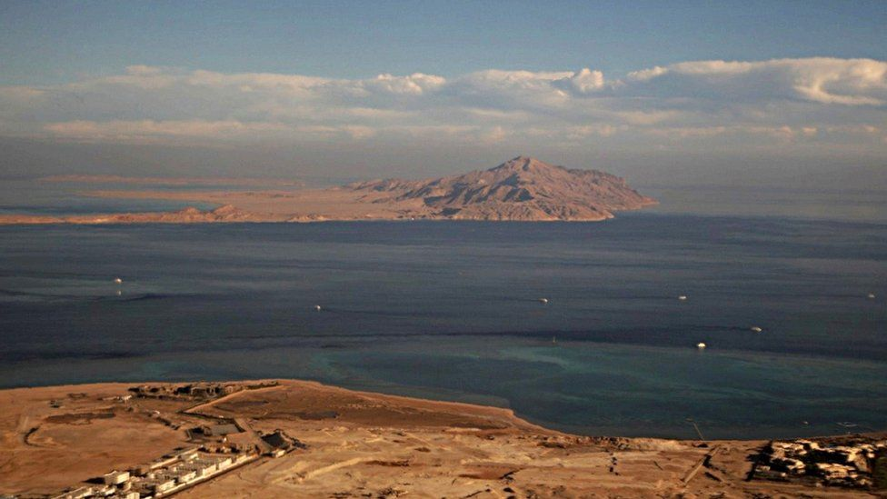 File photo taken on 14 January through the window of an airplane shows the islands of Tiran (foreground) and Sanafir (background) in the Red Sea