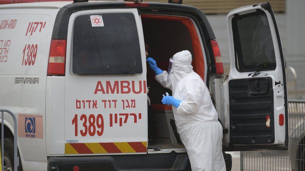 File photo of an Israeli ambulance and medic