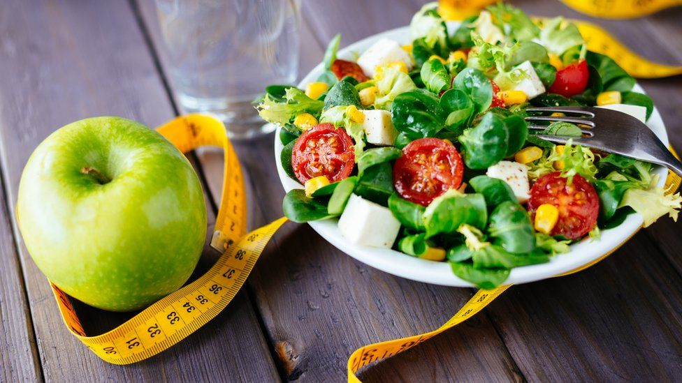 Healthy eating, apple and green salad