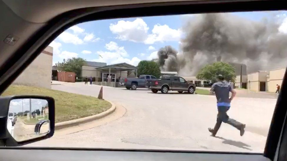 Smoke rises above the Coryell Memorial Hospital in Gatesville, Texas, 26 June 2018