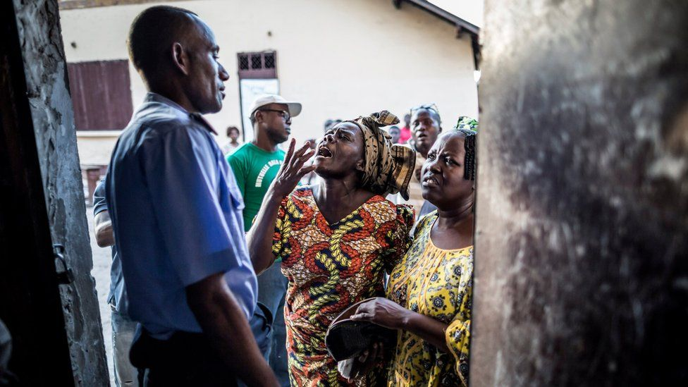 Congolese policeman tries to calm angry voters in Brazzaville