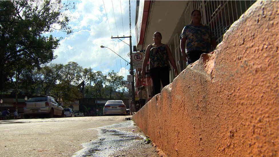 Pavement of the street inside the flood zone painted orange