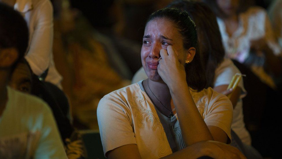 A woman cries on the steps to the Brumadinho Matriz church during a church service in honour of the missing people near the city of Brumadinho in the state of Minas Gerais, south-eastern Brazil, on January 31, 2019