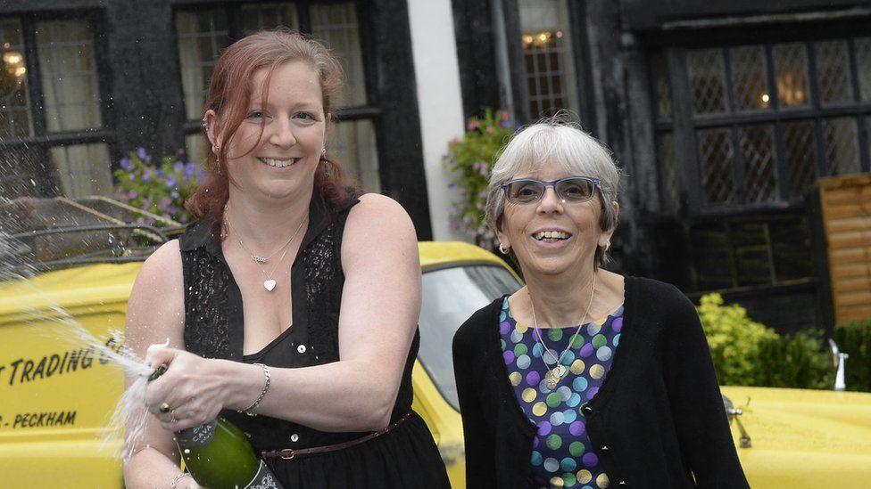Lottery winners spray champagne