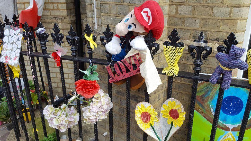 Tributes outside Notting Hill Methodist Church