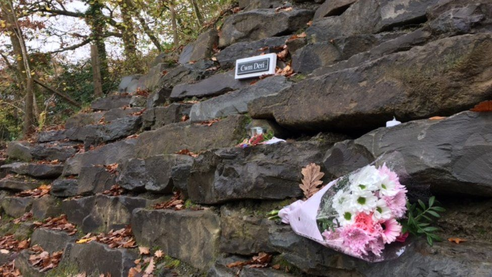 Floral tributes have been left in the village following the fire