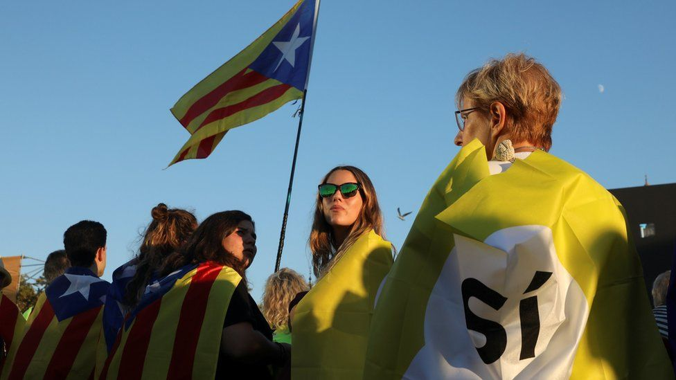 A woman holds a Catalan separatist flag in Barcelona, 29 October