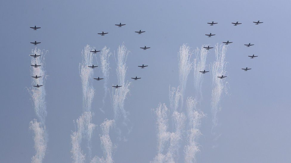 A formation of planes created the figures of 105 overhead