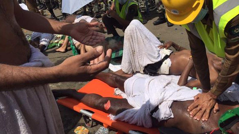 a pilgrim is treated by a medic after a stampede that killed and injured pilgrims in the holy city of Mina during the annual hajj pilgrimage