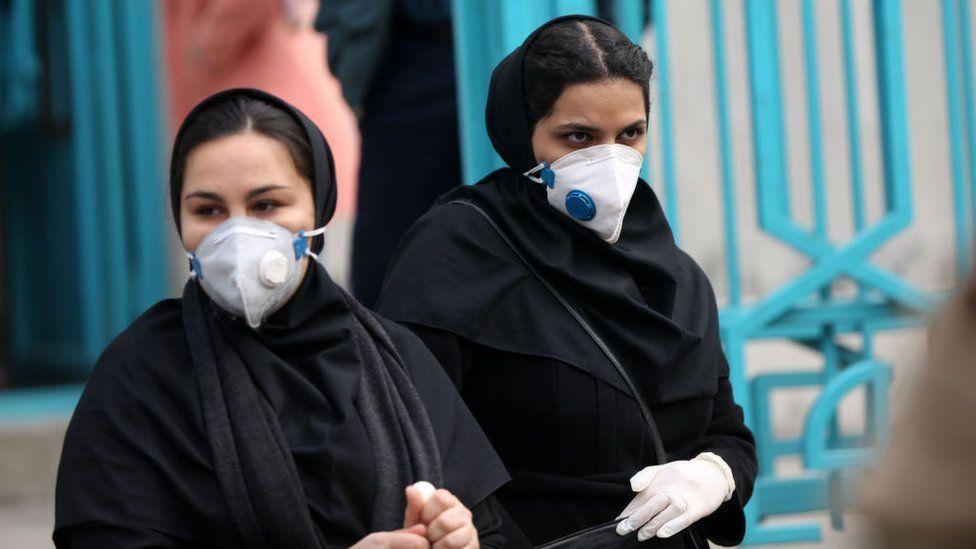 People wear face masks in Tehran