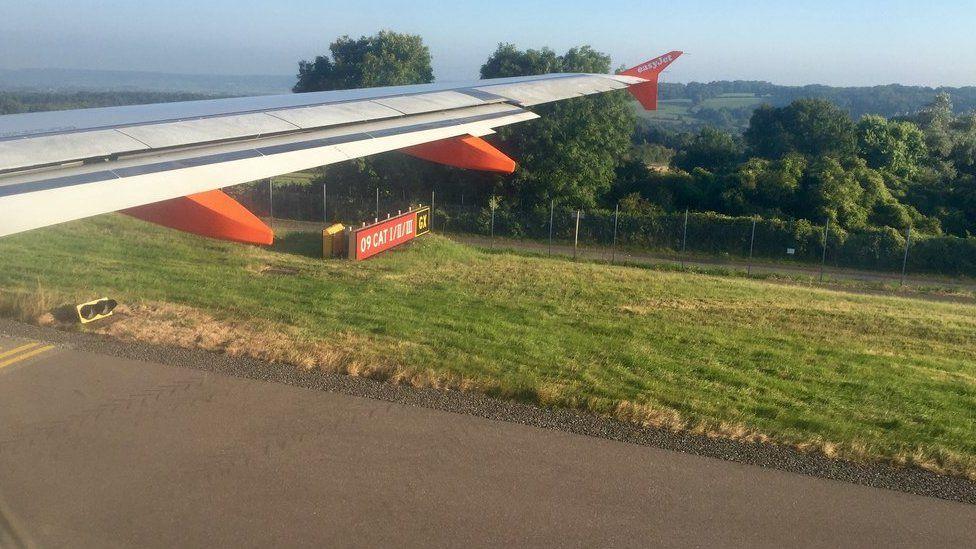 Plane wing with countryside in background