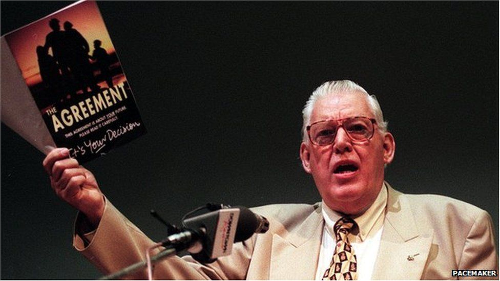 Ian Paisley holding a copy of the Good Friday Agreement Booklet
