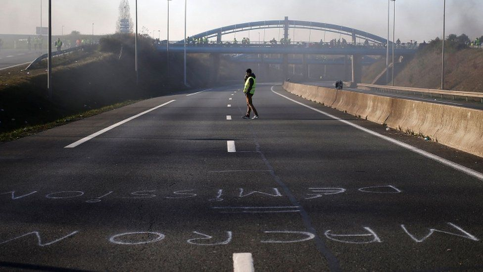 A man crosses an empty road in Caen, France