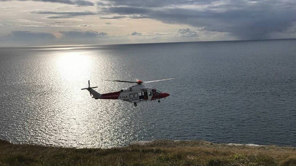 The coastguard helicopter during the rescue at Blacknor