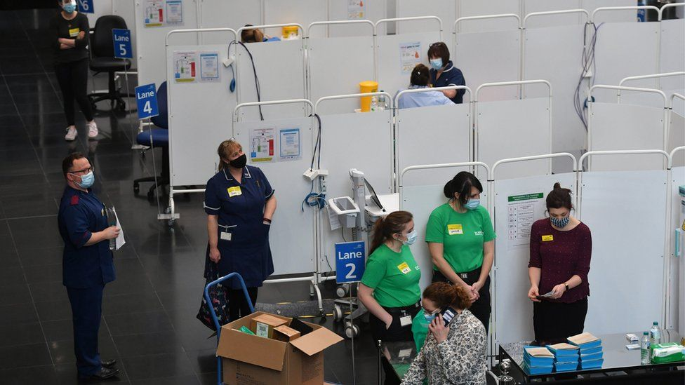 Members of staff prepare to administer injections of a Covid-19 vaccine at the NHS vaccine centre that has been set up at the Millennium Point centre in Birmingham