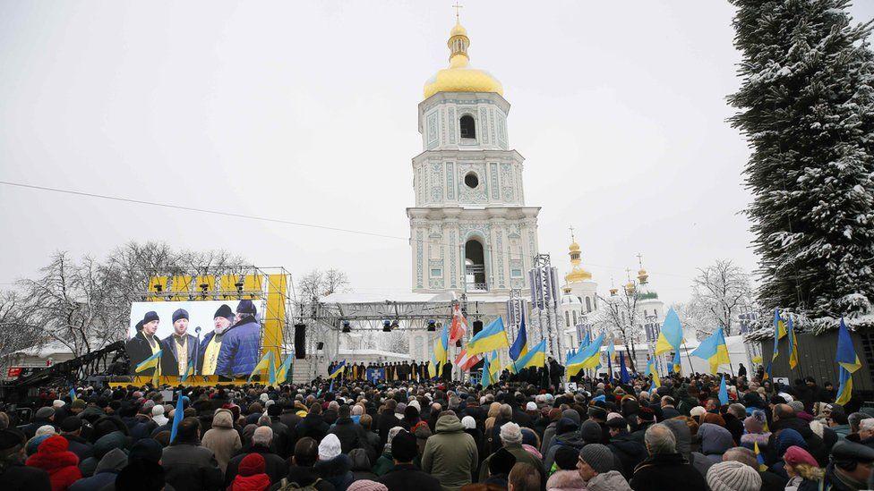 Ukrainians gather outside Saint Sophia's Cathedral bell tower in Kiev