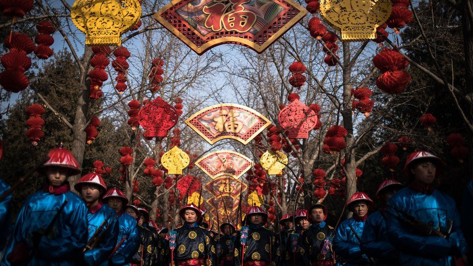 Chinese performers dressed in traditional costumes attend a rehearsal of a re-enactment of a Qing dynasty (1636-1912) imperial sacrifice ritual to worship the Earth, on the eve of the Chinese Lunar New Year