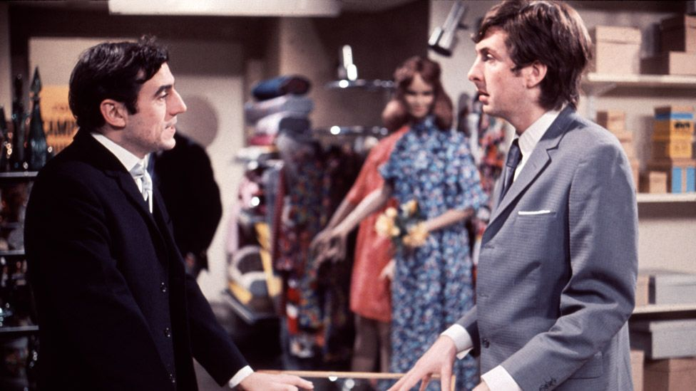 Jones (left) as the store manager and Eric Idle as Chris Quinn in Monty Python's sketch 'The Department Store-Buying an Ant