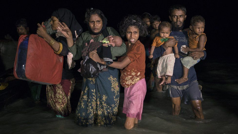 """Hundreds of Rohingya arrive by boats in the safety of darkness on Shah Porir Dwip island, Cox""""s Bazar, Bangladesh. 26 Sept 2017"""