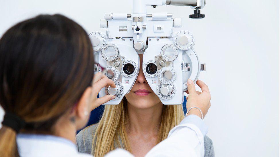 A woman getting an eye test