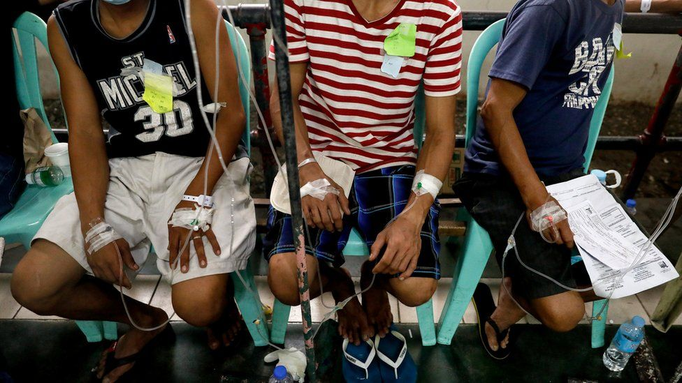 Patients poisoned after drinking coconut wine are treated at an emergency ward in Manila