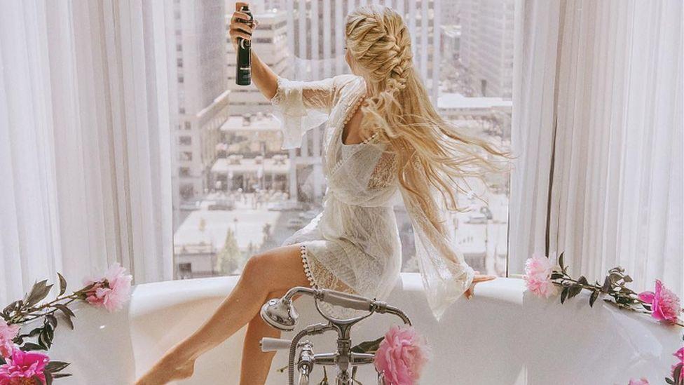 Instagram influencer Olivia Rink uses hair spray